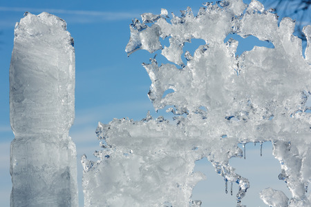 glacial: Melting glacial block of ice on blue sky background. Stock Photo