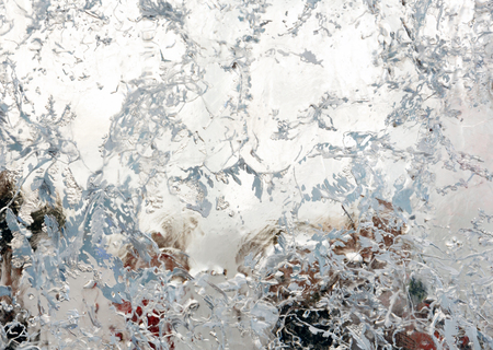 interspersed: Glacial transparent block of ice with interesting drawings and patterns