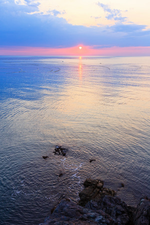 fascinate: Beautiful fascinate morning sea view with sunrise, sun track on surface and fishing nets.