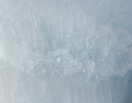 glacial: Glacial block of ice with interesting structure crystals macro. Winter background.