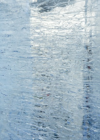 limpid: Glacial transparent block of ice (close up) with interesting drawings and patterns. Background.