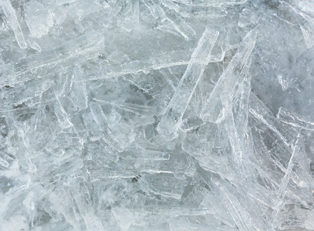 interspersed: Many elongated pieces of ice closeup. Winter background.