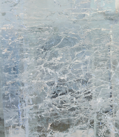 limpid: Glacial transparent wall of ice with interesting drawings and patterns . Closeup, background.