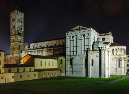 build in: Lucca (Tuscany, central Italy) city night view. The backside and bell tower of Lucca Cathedral of Saint Martin. Build in 1063.