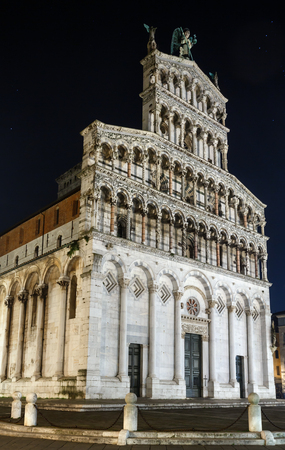 roman catholic: Lucca (Tuscany, central Italy) city night view. The San Michele in Foro (is  a Roman Catholic basilica church). Facade build in 13th century.