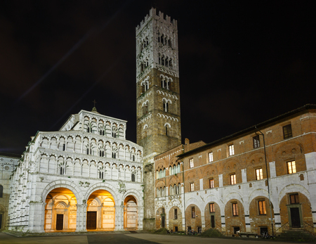 saint martin: Lucca (Tuscany, central Italy) city night view. The facade and bell tower of Lucca Cathedral of Saint Martin. Build in 1063.