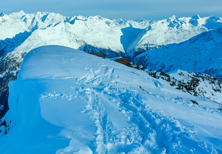 big scenery: Winter mountain scenery from hill top and big snowdrift hanging over the precipice   (Tyrol, Austria).