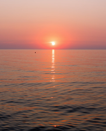 sun track: Beautiful fascinate morning sea view with sunrise and sun track on surface.