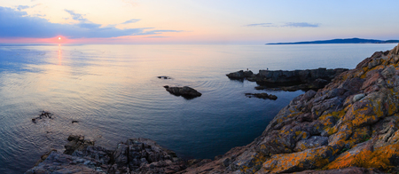 sun track: Beautiful fascinate morning sea panorama with sunrise, sun track on surface and fishing nets. Stock Photo