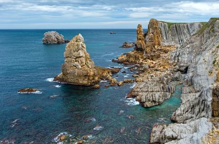 Arnia Beach (Spain) Atlantic Ocean coastline landscape. Stock Photo