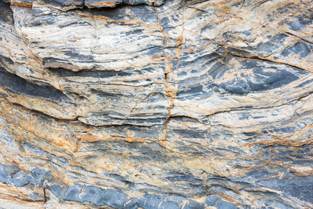 stratified: Part of rock close up.