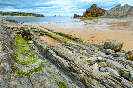 stratified: Detail of bare rocks because of low tide at cbeach (Pielagos, Cantabria) Stock Photo