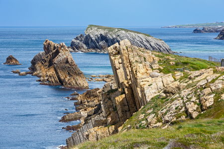 stratified: Atlantic ocean rocky coastline near Portio Beach, (Pielagos, Cantabria, Spain)
