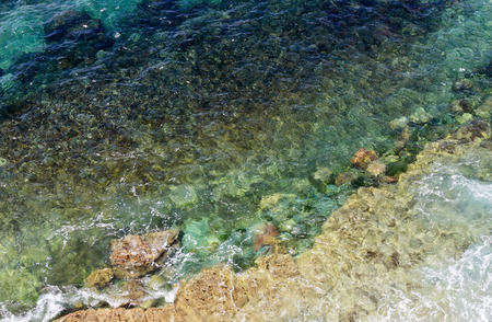 limpid: Limpid sea water surface with stones on bottom. View from above. Stock Photo