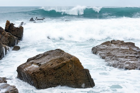 big scenery: Ocean scenery and big boulders. View from from Azkorri beach (Biscay, Basque Country, Spain). Stock Photo