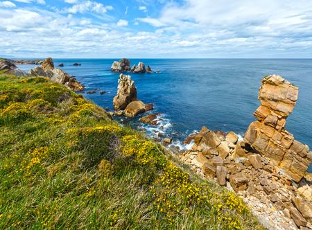 cantabria: Atlantic ocean rocky coastline near Portio Beach (Pielagos, Cantabria, Spain) Stock Photo