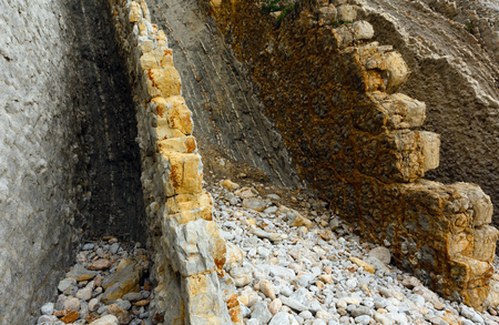 stratified: Detail of rock on Portio Beach in Pielagos,  Cantabria, Spain. Stock Photo