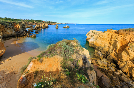 Sandy beach and summer Atlantic rocky coast top view (Albufeira outskirts, Algarve, Portugal).