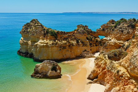 Top view on sandy beach Dos Tres Irmaos(Portimao, Alvor, Algarve, Portugal). Stock Photo