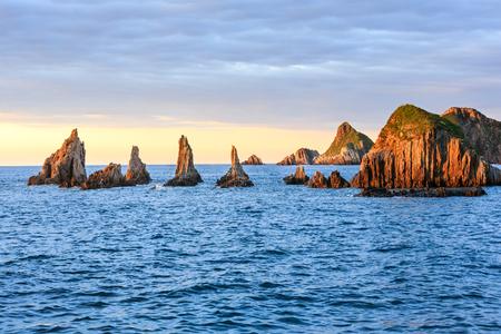 Sharp islets near Gueirua beach (Asturias, Spain). Evening Atlantic ocean landscape.