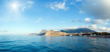 sudak: Summer sunshine morning rocky coastline and Genoese fortress (Sudak Town, Crimea, Ukraine).