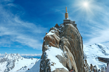 Sunshiny mountain top station of the Aiguille du Midi in Chamonix, France. All peoples is unrecognizable