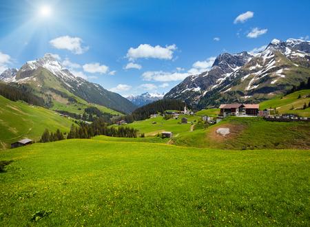 Sunshiny summer mountain view to Biberkopf mount (Warth, Vorarlberg, Austria).