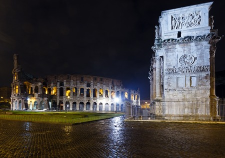 Colosseum and Constantine Arch night view in Rome, Italy (with some light flares) Stock Photo