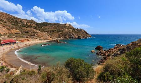 cartagena: CARTAGENA, SPAIN -  MAY 28, 2016: Summer rocky coast view with beach (near Cartagena, Costa Blanca, Spain). Editorial