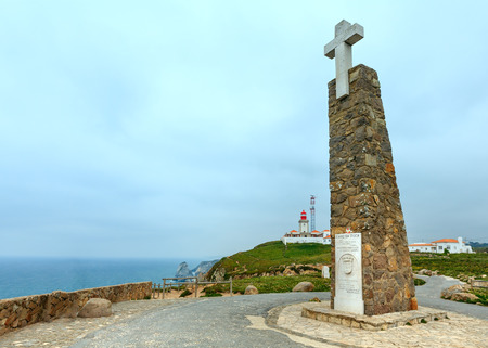 declaring: FISTERRA, PORTUGAL -  MAY 14, 2016: Monument declaring Cabo da Roca as the westernmost extent of continental Europe and Lighthouse. Portugal.