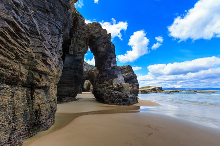 Natural rock arches on Cathedrals beach in low tide (Cantabric coast, Lugo, Galicia, Spain).