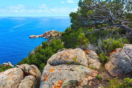 Summer sea rocky coast view. Coastline between Barcelona and Palamos (Costa Brava, Catalonia, Spain). Stock Photo