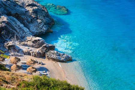 Morning summer Ionian sea coast and beach with transparent aquamarine water, Albania. Stock Photo - 67007645