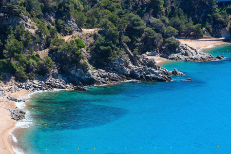 beaches of spain: Summer sea rocky coast view with small sandy beaches (Spain).