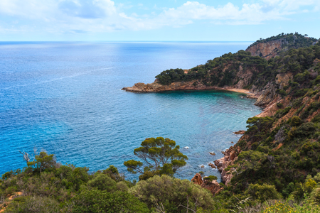 Summer sea rocky coast view with small sandy beach. Costa Brava, Catalonia, Spain. Stock Photo