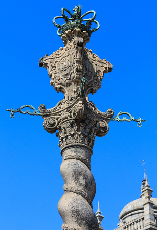 law of portugal: Medieval pillory top on blue sky background. Located on square in front of Porto Cathedral, Portugal. Stock Photo