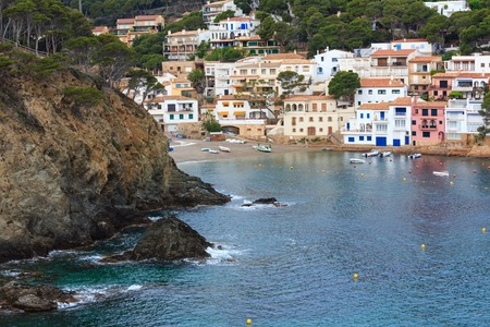Costa Brava, Spain -  June 1, 2016: Sea bay summer view with town on coast.