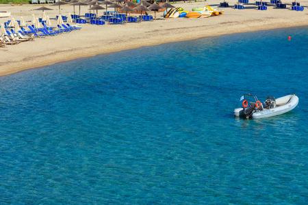 Summer morning  Platanitsi beach with sunbeds (Sithonia, Chalcidice, Greece).