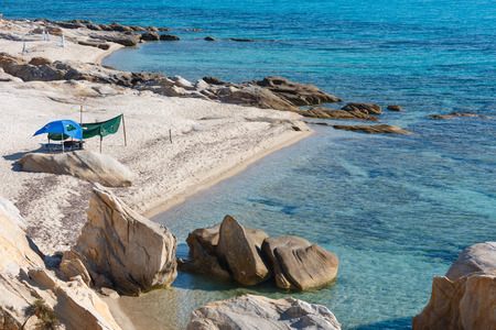 sunshade: Summer morning sandy beach and rocky coast near Platanitsi Beach (Sithonia Peninsula, Chalcidice, Greece).