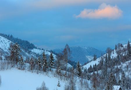 Evening sky with pink cloud over winter Ukrainian Carpathian Mountains. Stock Photo