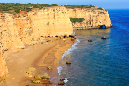Summer Atlantic rocky coast view with sandy beach Praia da Afurada (Lagoa, Algarve, Portugal). Stock Photo