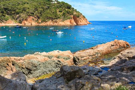 Tamariu bay summer coast view with boats, Costa Brava in Catalonia, Spain. People are unrecognizable. Stock Photo