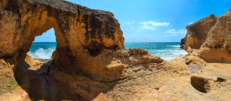 Summer Atlantic rocky coast view (Albufeira outskirts, Algarve, Portugal). Two shots stitch image. Stock Photo