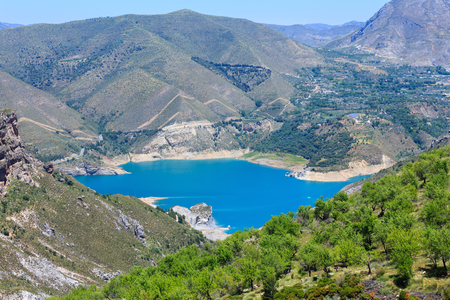 Blue lake in Sierra Nevada National Park, near Granada, Spain. Summer mountain landscape. Stock Photo