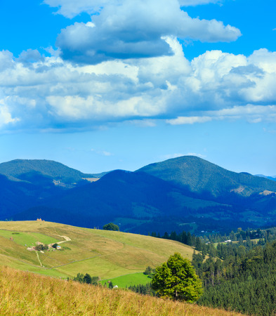Beautiful blue sky with white cumulus clouds over summer Carpathian mountain (Ukraine, Verkhovyna district, Ivano-Frankivsk region). Three shots stitch image.