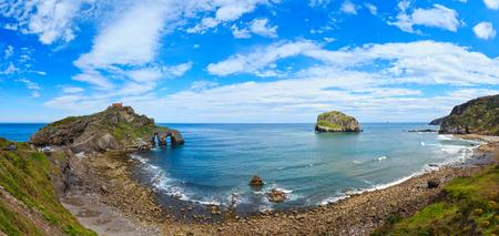 Doniene Gaztelugatxeko hermitage on top of Gaztelugatxe island. Biscay bay (Spain). Two shots stitch high-resolution panorama.