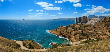 Skyscrapers on rocky coast. Benidorm city coastline summer view (Costa Blanca, Alicante, Spain). Two shots stitch panorama.