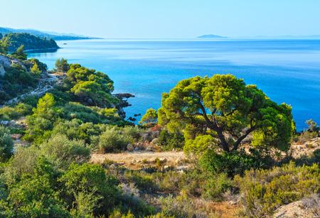 Morning summer Aegean Sea coastline (Nikiti, Sithonia, Halkidiki, Greece).