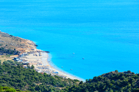 Adriatic sea summer coast with beach (Lukove komuna, Albania). View from mountain pass. People unrecognizable.
