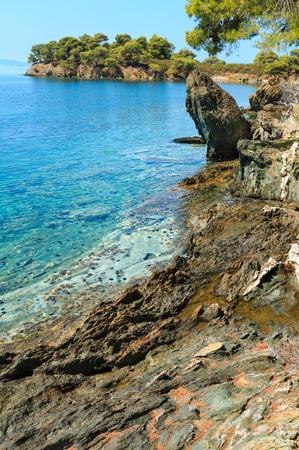 Morning summer Aegean Sea rocky coast landscape with pine trees on shore, Sithonia (near Ag. Kiriaki), Halkidiki, Greece. Stock Photo